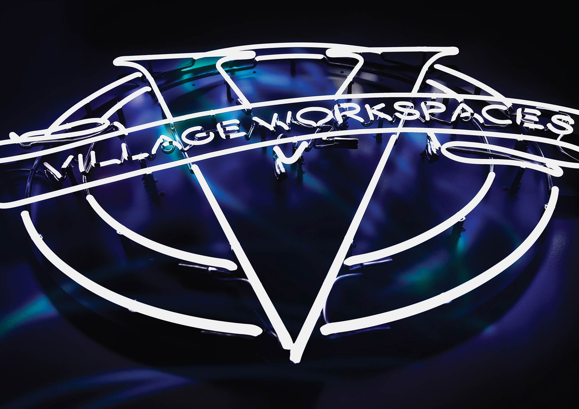 village-workspaces-logo-neon